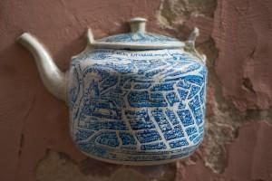 teapot inside a wall in vilnius